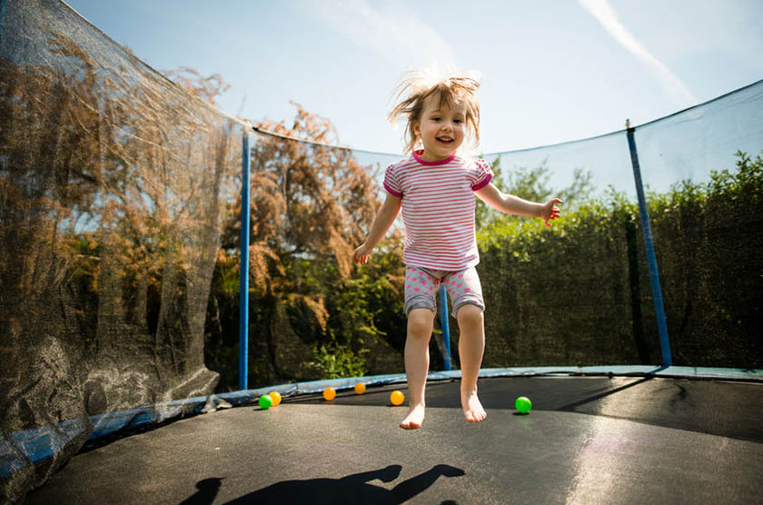 70373185 - child jumping trampoline